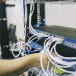 Picture of Managed IT Services technician working on server rack